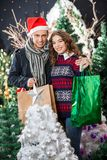 Couple With Shopping Bags Standing At Christmas Royalty Free Stock Photos
