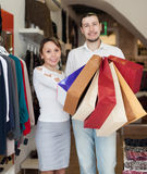 Couple  with shopping bags at  store. Couple  with shopping bags at clothing store Royalty Free Stock Images