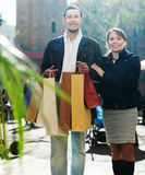 Couple with shopping bags at  street Royalty Free Stock Photos