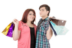 Couple with shopping bags in variety of colors. Royalty Free Stock Photography