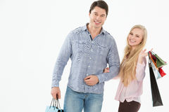 Couple with shopping bags. On a white background Stock Image