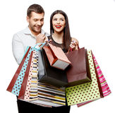 Couple with shopping bags. Young Couple with shopping bags isolated on white Stock Photos