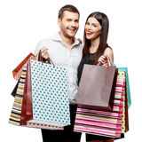Couple with shopping bags. Young Couple with shopping bags isolated on white Royalty Free Stock Photography