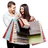 Couple with shopping bags. Young Couple with shopping bags isolated on white Royalty Free Stock Photos