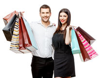 Couple with shopping bags. Young Couple with shopping bags isolated on white Royalty Free Stock Images