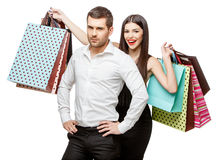 Couple with shopping bags. Young Couple with shopping bags isolated on white Stock Photo