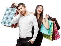 Couple with shopping bags. Young Couple with shopping bags isolated on white Stock Images