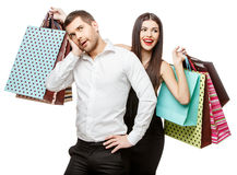 Couple with shopping bags. Young Couple with shopping bags isolated on white Stock Photography