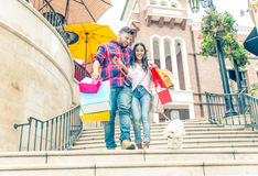 Couple shopping in Beverly Hills. Couple having fun and shopping in Beverly Hills - Lovers walking with dog and buying gifts in a shopping mall Royalty Free Stock Photography