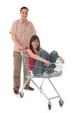 Couple with shopping cart royalty free stock photos
