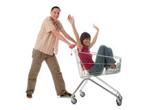 Couple with shopping cart Stock Images