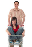 Couple with shopping cart Stock Photo