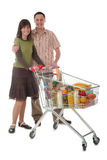 Couple with shopping cart. Young couple with shopping cart Stock Photography