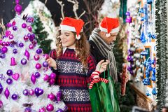 Couple Shopping For Christmas Decorations Stock Photos