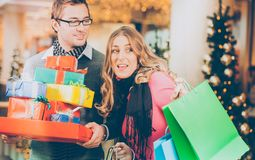 Couple shopping  Christmas presents and bags in mall Stock Photo