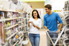 Couple shopping DIY tools. Young couple shopping for DIY tools at hardware store stock image