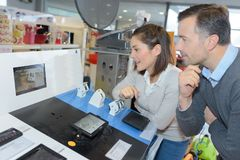 Couple shopping in electronic store Stock Image