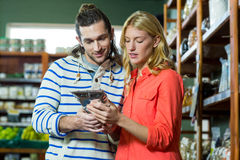 Couple shopping for groceries Stock Photography