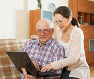 Couple shopping at home via  Internet Stock Images