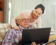 Couple shopping at home via  Internet Stock Image
