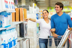 Couple shopping hypermarket. Smiling couple shopping at hypermarket Royalty Free Stock Image