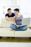 Couple shopping on internet Stock Photos