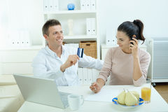 Couple shopping on internet Stock Image
