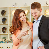 Couple shopping at jeweler Royalty Free Stock Photo