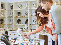 Couple shopping in jewelry store Stock Photos
