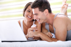 Couple shopping on line with credit card Stock Photo