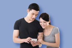 Couple shopping and looking at cellphone Stock Photos