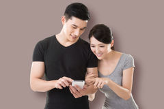 Couple shopping and looking at cellphone Royalty Free Stock Photo