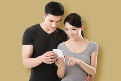 Couple shopping and looking at cellphone Royalty Free Stock Images