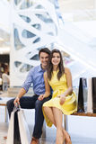 Couple in shopping mall Stock Image