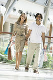 Couple shopping in mall Royalty Free Stock Photos