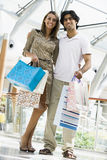 Couple shopping in mall. Carrying bags Stock Photo