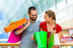 Couple shopping in mall with bags Royalty Free Stock Images