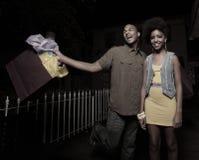 Couple shopping at night Royalty Free Stock Photos