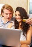 Couple shopping online Stock Photos