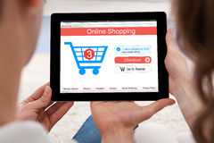 Couple Shopping Online On Digital Tablet Royalty Free Stock Photo