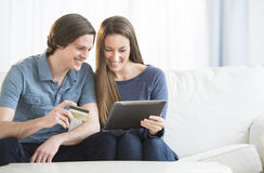 Couple Shopping Online On Digital Tablet Stock Photography