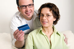 Couple shopping online, paying by credit card Royalty Free Stock Image