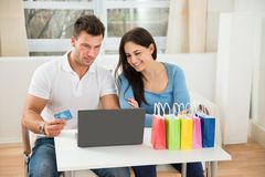 Couple shopping online Stock Photography