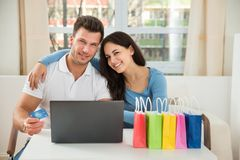 Couple shopping online Stock Images