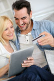 Couple shopping online with tablet from home Stock Photography