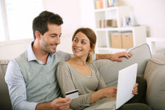 Couple shopping online together on internet Royalty Free Stock Image