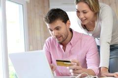 Couple shopping online Stock Photo