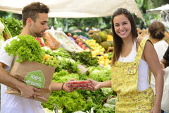 Couple shopping at open street market. Royalty Free Stock Photography