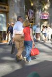 Couple shopping on Passeig de Gr�cia in the Eixample district, busy street in Barcelona, Spain, Europe Stock Photography