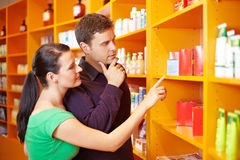 Couple shopping in pharmacy. Couple shopping for medical products in a pharmacy Royalty Free Stock Image